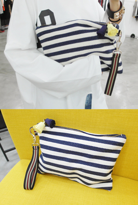 Striped tassels clutch