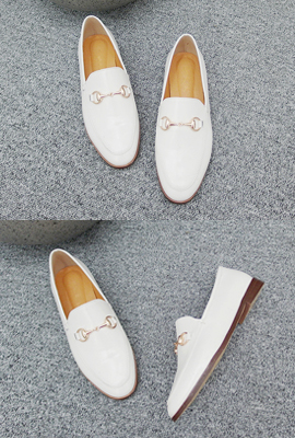 Brass buckle loafers