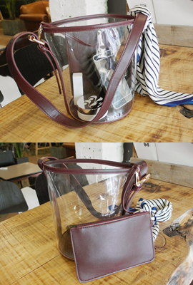 Transparent cylindrical shoulder bag