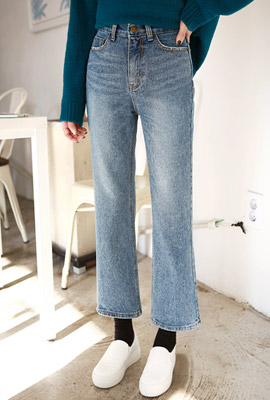 High-heeled boots cut denim pants
